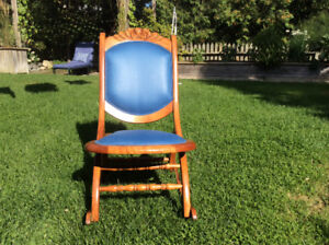 Antique folding chair. Excellent condition, new upholstery
