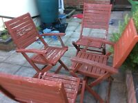 5 old fold up wooden garden chairs.