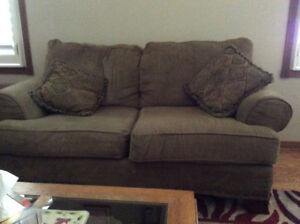 Couch and love seat two end tables and a coffee table