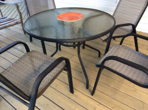 PATIO TABLE AND FOUR CHAIRS...VERY GOOD USED CONDITION