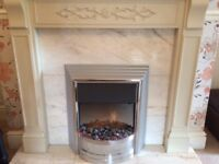 Electric fire with marble surround