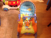 Chaise Fisher Price, état neuf, 25$