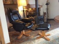 Black leather swivel recliner with leather foot stool