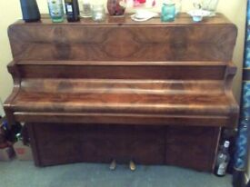 Bentley upright piano, lovely tone and action