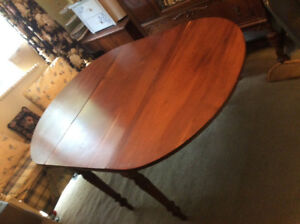Antique cherrywood dropleaf dining table