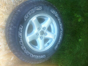 one new 225 75 15 good year wrangler RT S on jeep rim