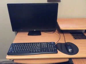 """24"""" HP monitor with keyboard and mouse."""