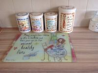 Ceramic tea, coffee, sugar, cookie jar and chopping board