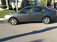 2007 Toyota Corolla  & Michelin plus winter tires on rims