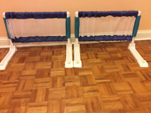bed rails. ( safety 1st). 63cm long each.Excellent condition.