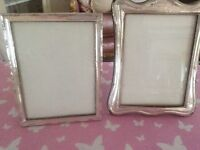 Silver picture frames.