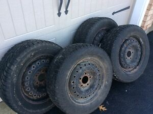 Two pairs of winter snow tires on steel rims Kitchener / Waterloo Kitchener Area image 1