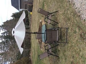 Patio set and umbrella for sale