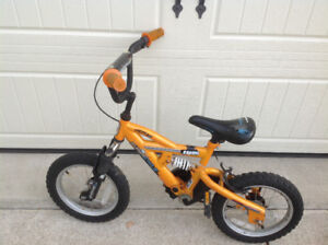 "Supercycle 12""wheel mountain bike with rear brake & shocks.  A1"