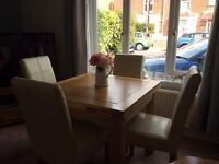 Solid oak dining room table + 4 cream leather chairs