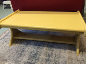 Coffee table in soft yellow tones