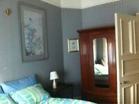 A bright double ensuit room in the lovely house