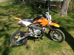 Looking to trade dirt bike for quad