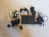 Ps2 slim black console & games