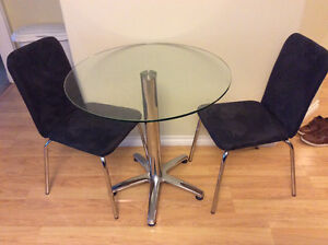 Glass bistro table with two chairs for sale