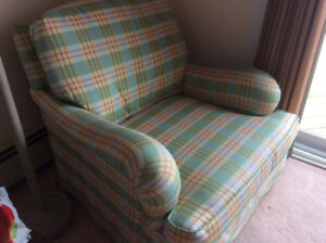 Reduced pair of down filled arm chairs by designer