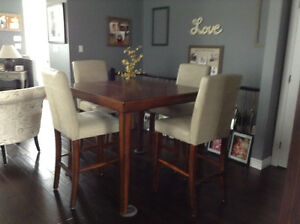 Pub style dining table and. 4 chairs