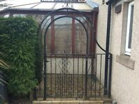 Wrought iron garden gate and arch
