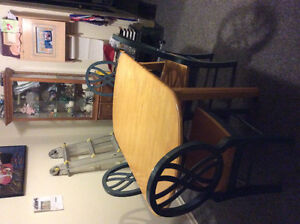 Used solid wood dining table plus 4 matching chairs.