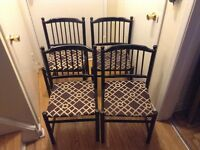 4 black wood chairs in good condition