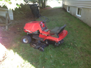 Ride on lawn mower for parts.