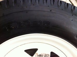 Trailer Tire with Rim, and one extra Rim