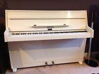 White compact Zender piano