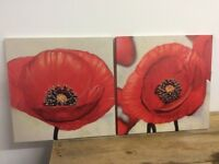 2 matching paintings of flowers