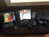 Sony Play station 2 with games and sing it microphones