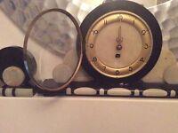 Art Deco clock with garnitures