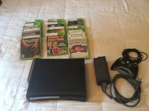XBOX 360 with 12 games and a controller