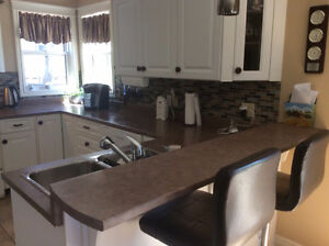 Kitchen Counter top and breakfast nook. 25(ft.)