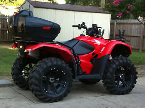 2015 Honda 4 wheeler for sale like brand new