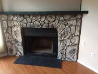 Large Stone fireplace with wood mantle