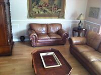 Couches leather and coffee tables