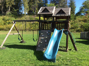 Gently used outdoor swingset, play center .