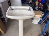 Pedestal basin, toilet , taps and bathroom cabinet.