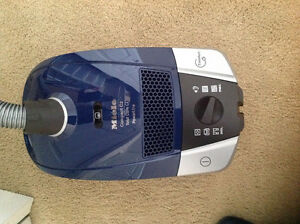 Compact Miele vacuum cleaner C2 blue with all attachment.