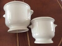 Two Grecian style white plant holders / pots.