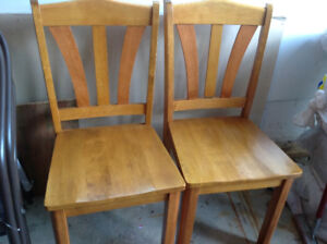 2 wood chairs light brown color