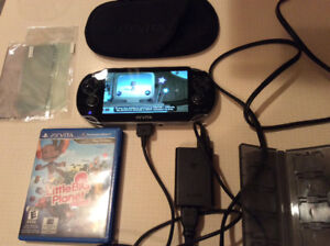 Ps vita + chargeur + little big planet + extra