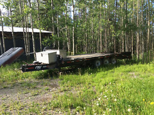 1990 International dump truck with tri-axle trailer