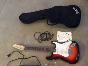 Electric guitar with amp, case, headphones, picks, and more