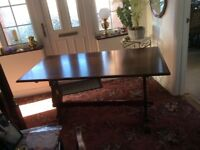 Solid oak refectory table and four chairs.