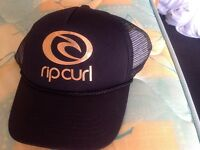 Brand new with tags Rip Curl hat in black and gold